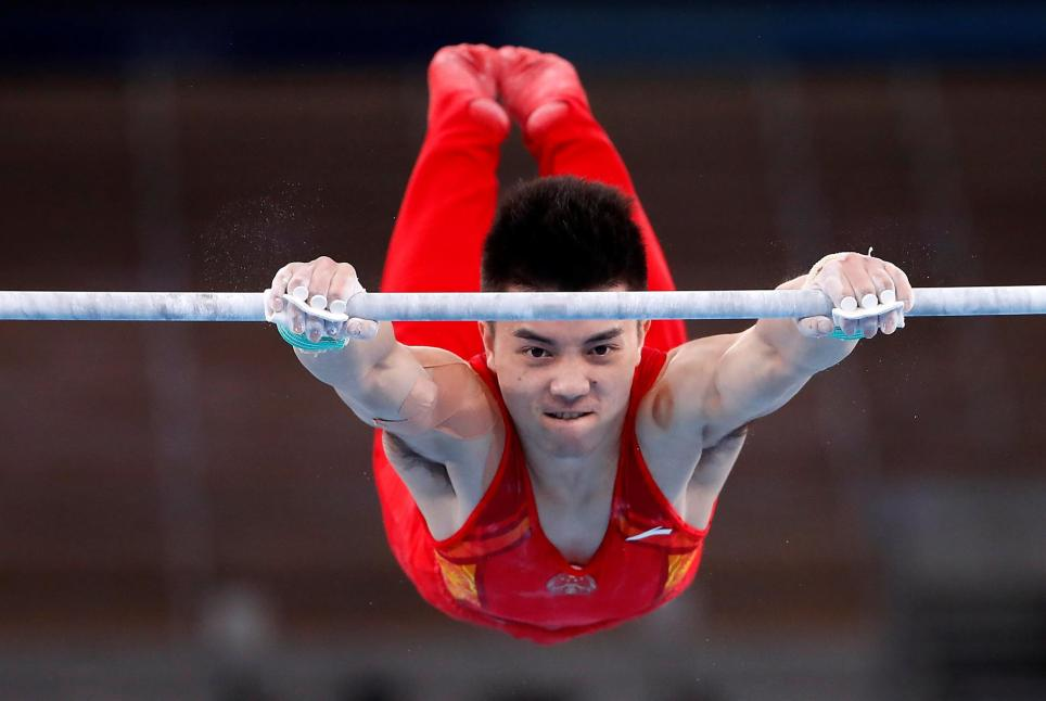 Lin Chaopan of China performs during the Horizontal Bar men's Team final during the Artistic Gymnastics events of the Tokyo 2020 Olympic Games.EFE/EPA/TATYANA ZENKOVICH